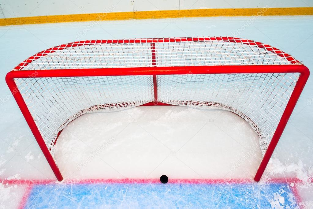 depositphotos 31747895-stock-photo-hockey-goal-with-puck-on